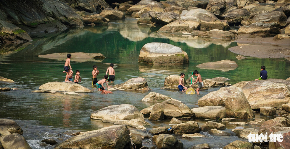 Children of a village in Sa Pa Town swim in a stream. Photo: Nguyen Sieu Hanh