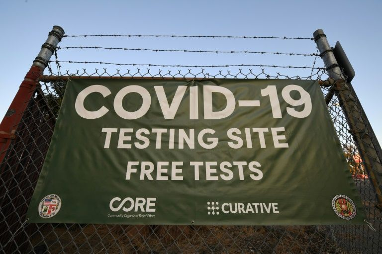 A sign is seen outside a Covid-19 testing site in Los Angeles, California as the state followed Texas and became the second in the US to surpass one million coronavirus infections, November 12, 2020. Photo: AFP