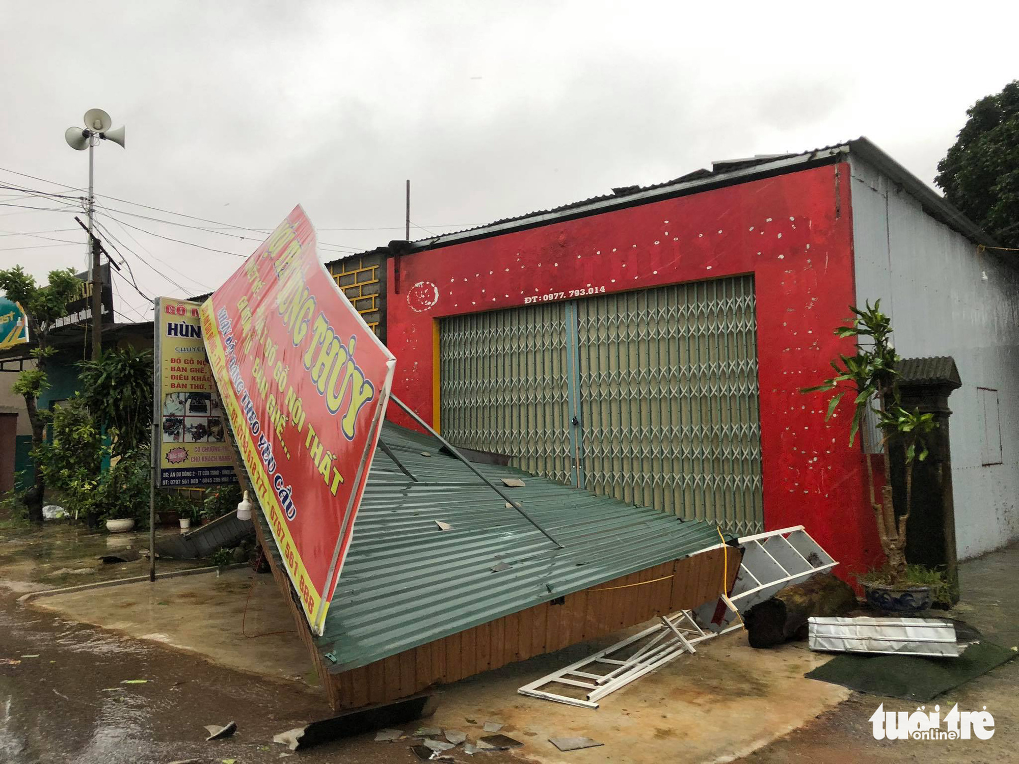A signboard is knocked down by strong wind in Quang Tri Province, Vietnam, November 15, 2020. Photo: Huu Kha / Tuoi Tre