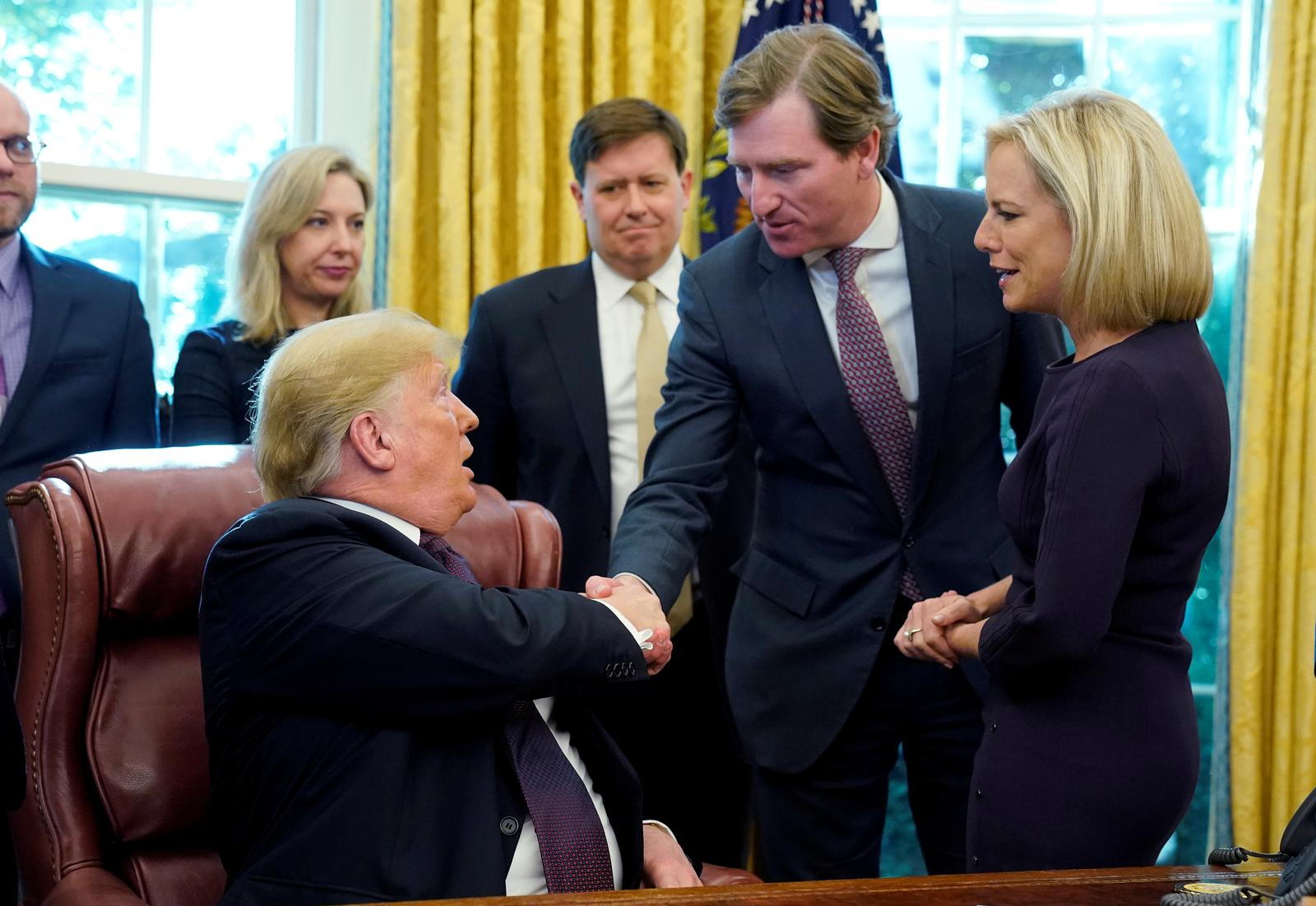 U.S. President Donald Trump shakes hands with Chris Krebs, the director of the Cybersecurity and Infrastructure Security Agency (CISA) as DHS Secretary Kirstjen Nielsen (R) looks on after a signing ceremony for the Cybersecurity and Infrastructure Security Agency Act in the Oval Office of the White House in Washington, U.S. November 16, 2018. Photo: Reuters
