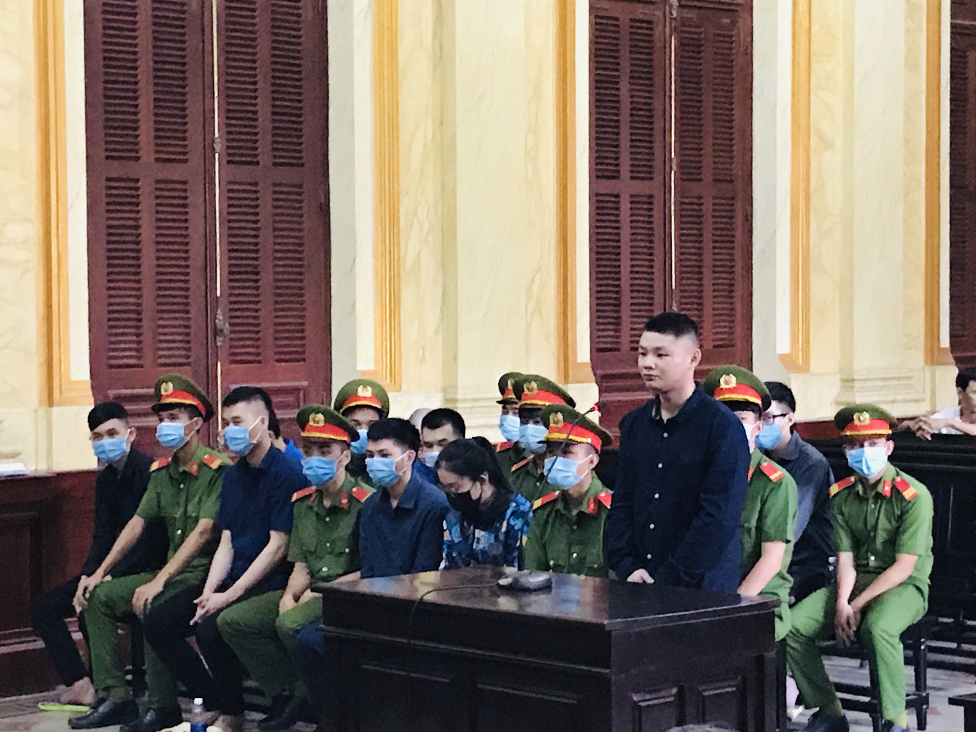 Three Chinese and seven Vietnamese defendants are pictured during the trial at the Ho Chi Minh City People's Court on November 19, 2020. Photo: Tuyet Mai / Tuoi Tre