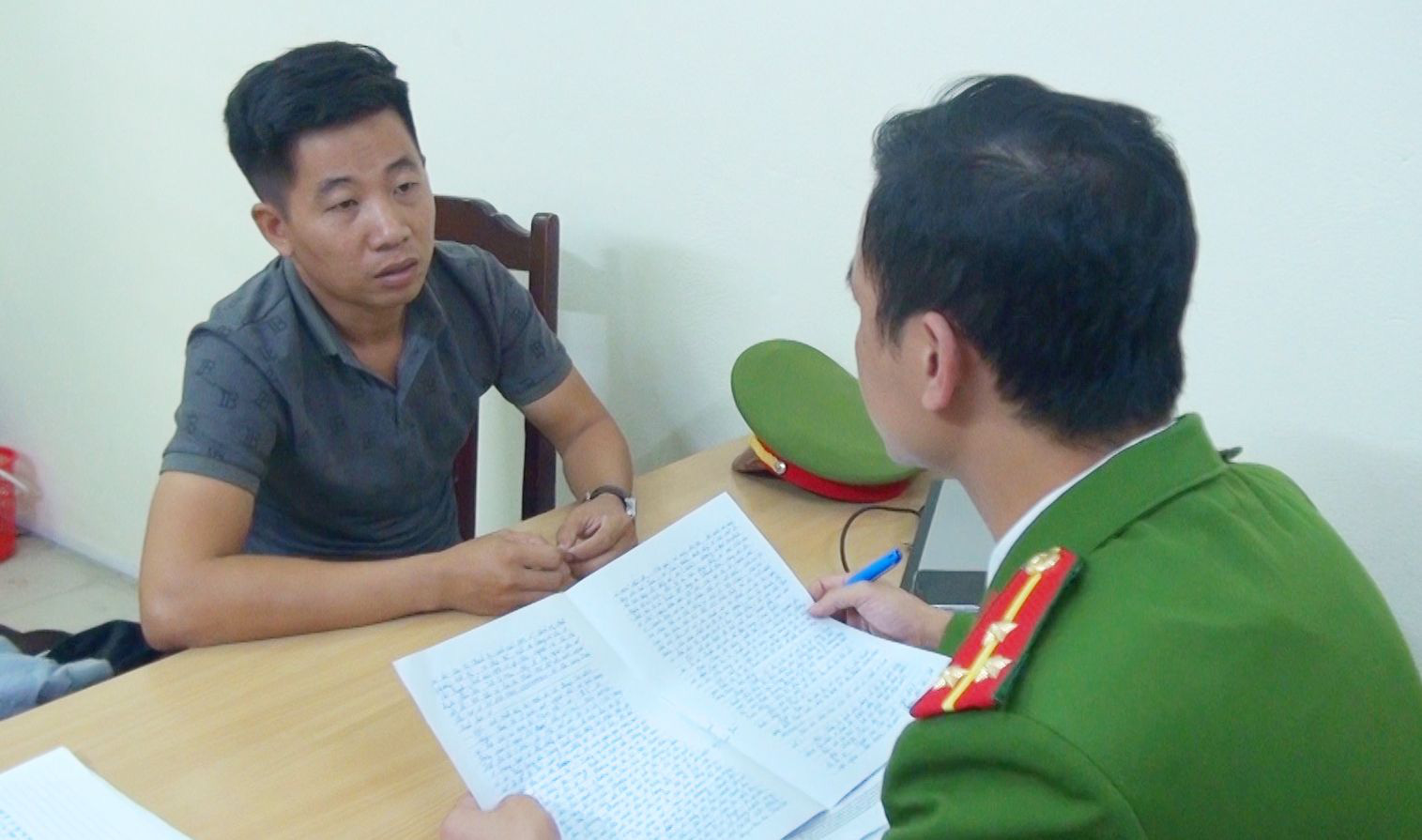 Nguyen Chau Tuan works with a police officer in Thanh Hoa Province, Vietnam in this supplied photo.