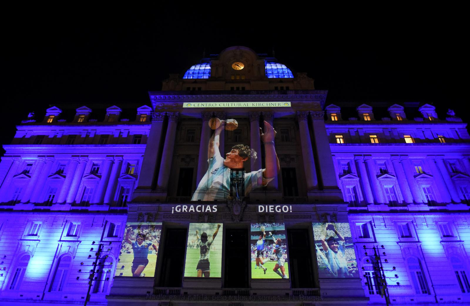 Photographs of late soccer legend Diego Maradona are projected on the Kirchner Cultural Centre, in Buenos Aires, Argentina November 25, 2020. Photo: Reuters