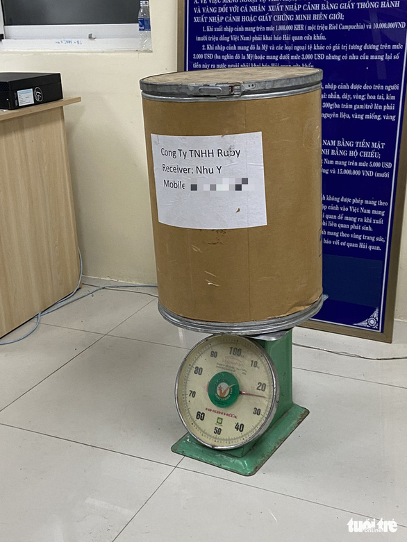 A cylinder-shaped carton box with 20.8kg of suspected narcotics is pictured at the police station in Tinh Bien District, An Giang Province, November 26, 2020. Photo: Buu Dau / Tuoi Tre