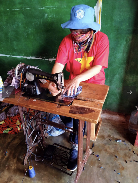This supplied photo shows Lieutenant Colonel Nguyen Thi Lien sewing face masks to give to colleagues in the mission and the people of Bangui City, Central African Republic.