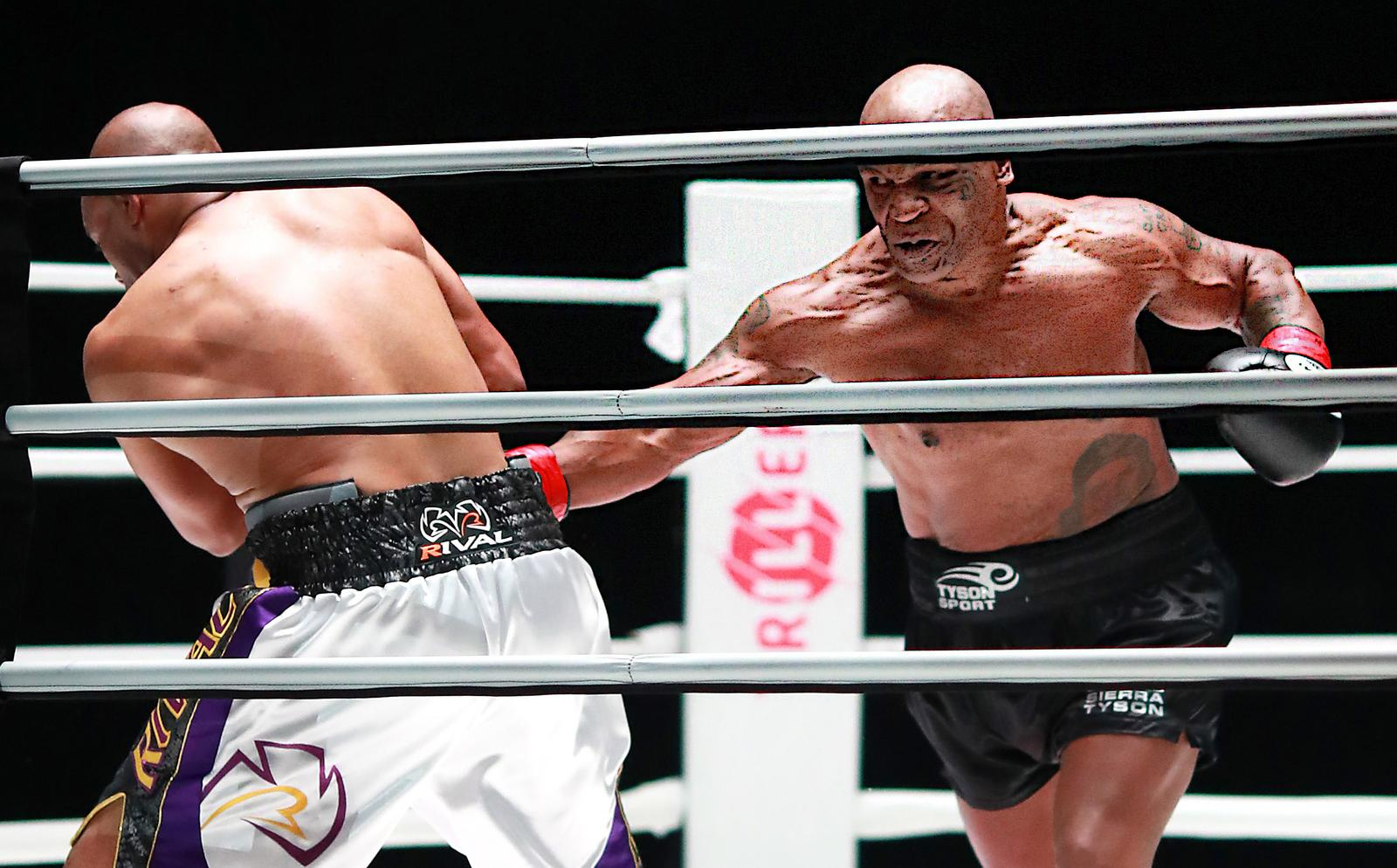 Tyson fights to draw with Jones Jr. in exhibition