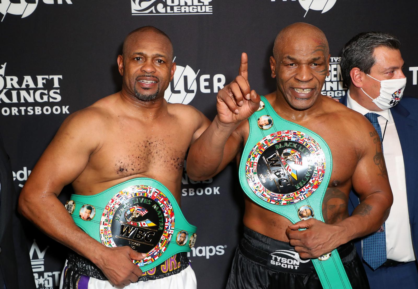Nov 28, 2020; Los Angeles, CA, USA; Mike Tyson and Roy Jones, Jr. pose with their belts after a split draw during a heavyweight exhibition boxing bout for the WBC Frontline Belt at the Staples Center. Mandatory Credit: Joe Scarnici/Handout Photo via USA TODAY Sports