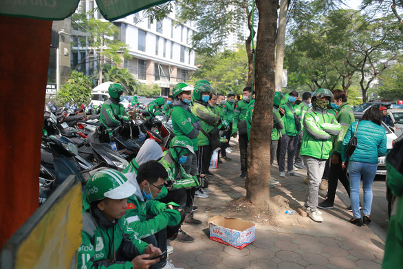 Striking drivers are seen in front of a Grab Vietnam office in Hanoi on December 7, 2020. Photo: Anh Dinh / Tuoi Tre