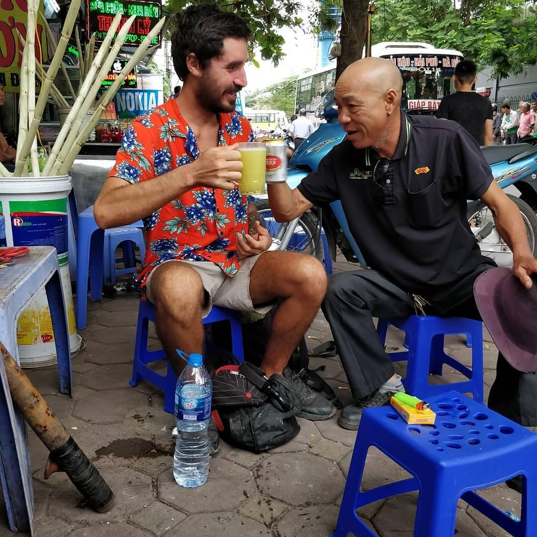 Pablo Salvatierra makes a toast with a local man in Hanoi. Photo: Instagram/sweetconscience