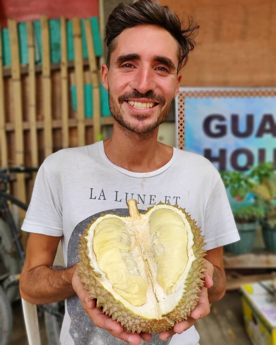 Pablo Salvatierra happily holds a durian. Photo: Instagram/sweetconscience