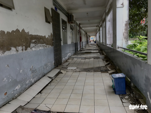 Tiles are loose in a corridor at the Ho Chi Minh Mental Health Hospital's branch on Le Minh Xuan Street in Binh Chanh District, Ho Chi Minh City.