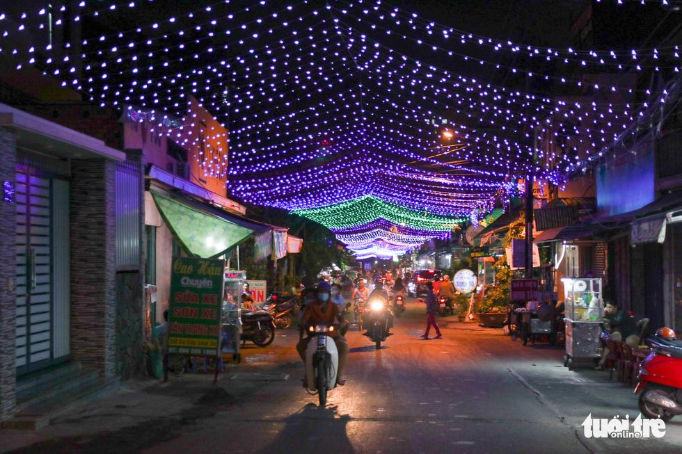Christian neighborhoods in Saigon deck the halls for Christmas season
