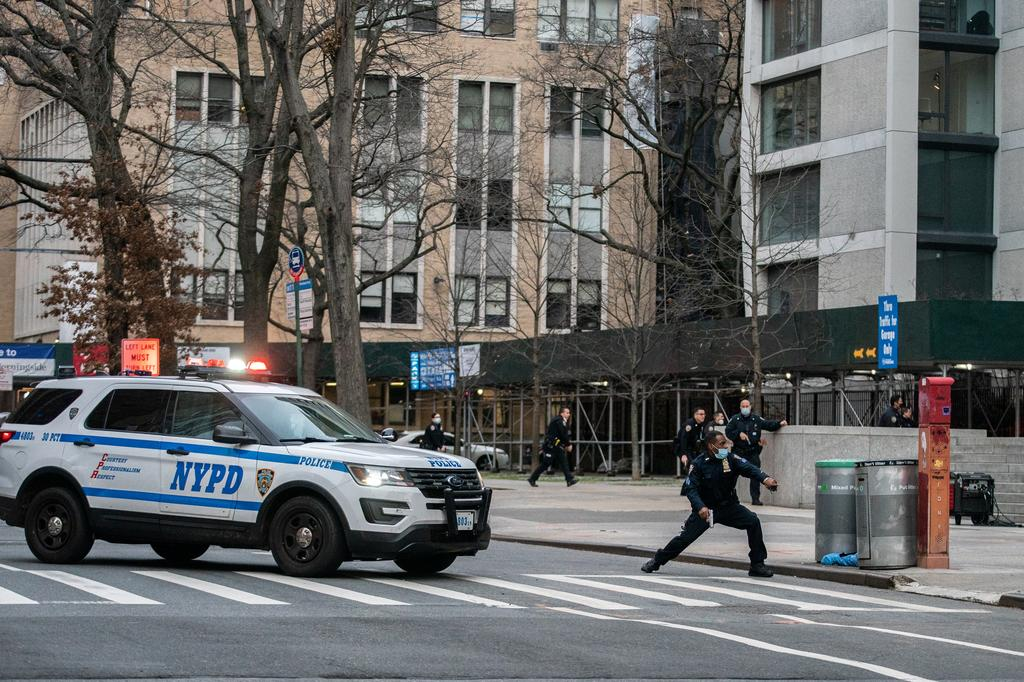 Police officers and a NYPD vehicle arrive after a man opened fire outside the Cathedral Church of St. John the Divine in the Manhattan borough of New York City, New York, U.S., December 13, 2020. Photo: Reuters