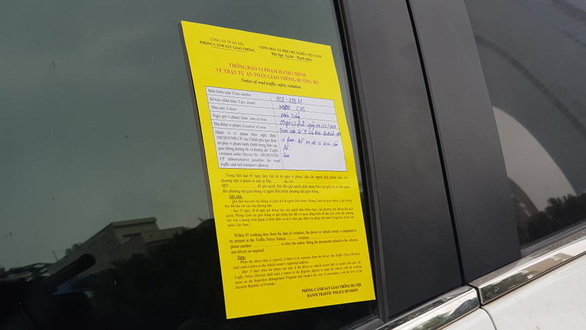 A parking ticket is stuck on a windshield of a car on a street in Hanoi on December 14, 2020. Photo: Quang Hieu