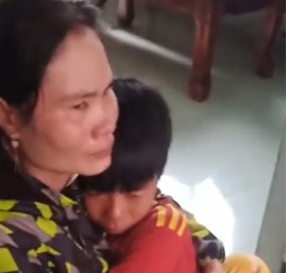 This screenshot from a video show the reunion moment of a boy with his mother.