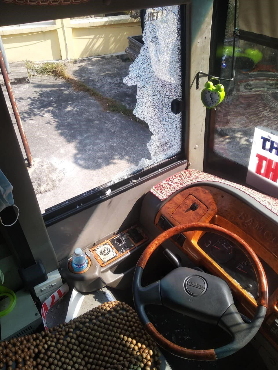 The window of the passenger bus driven by Nguyen Minh Lap is broken after the vehicle was attacked with rocks in this supplied photo.