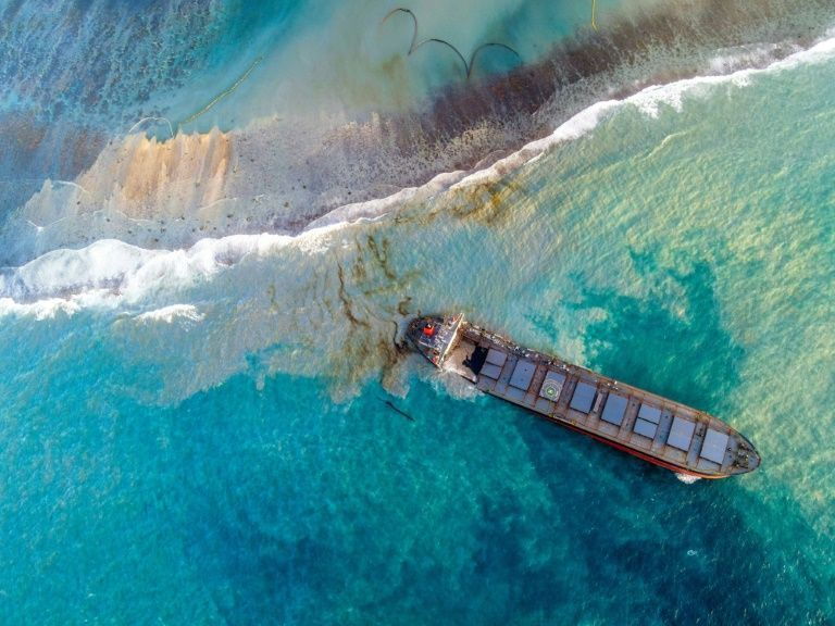 This aerial view taken on August 8, 2020 shows a large patch of leaked oil and the vessel MV Wakashio, belonging to a Japanese company but Panamanian-flagged, that ran aground near Blue Bay Marine Park off the coast of south-east Mauritius. Photo: AFP