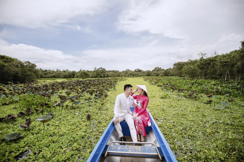 Newlyweds Hoang Anh and Quynh Hoa are seen in their pre-wedding photo taken at Tra Su Cajuput Forest in An Giang Province.