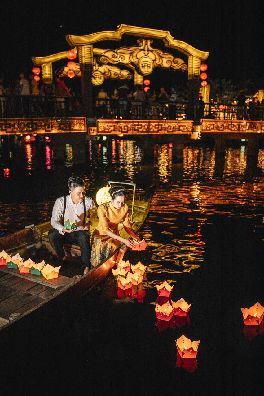 Newlyweds Hoang Anh and Quynh Hoa are seen in their pre-wedding photo taken in Hoi An City of Quang Nam Province.