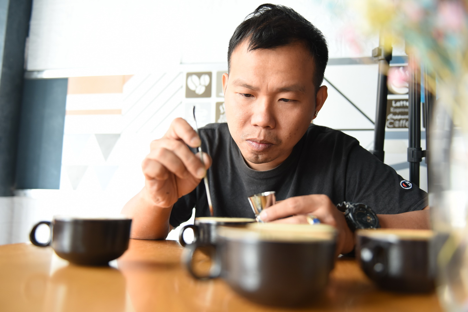 Cao Truong Minh is working on a cup of egg coffee before serving it to his customer at his coffee shop in Ho Chi Minh City's Binh Thanh District. Photo: Ngoc Phuong/ Tuoi Tre