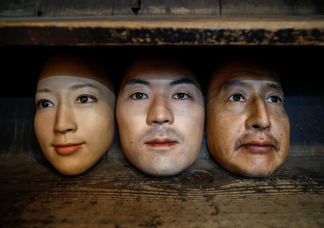 Masks based on real people's faces are diplayed at the Shuhei Okawara's mask shop in Tokyo, Japan December 16, 2020. Photo: Reuters