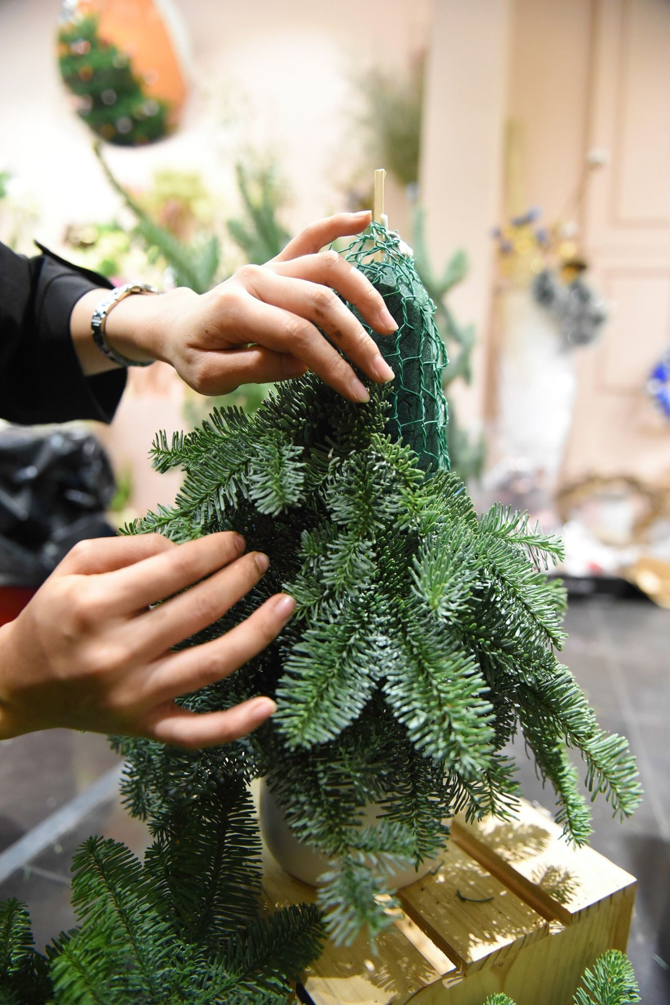 Noble fir branches are shaped into a Christmas tree at a shop in Ho Chi Minh City's District 3. Photo: Ngoc Phuong/ Tuoi Tre News