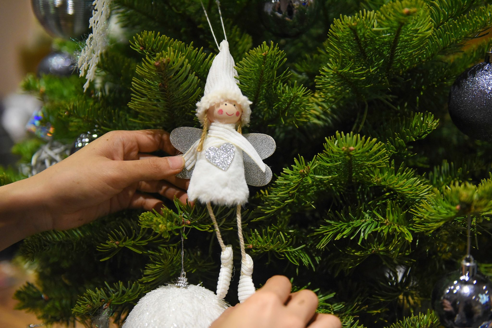 An angel ornament is seen on a noble fir at a shop in Ho Chi Minh City's District 3. Photo: Ngoc Phuong/ Tuoi Tre News