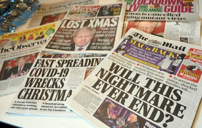 British newspaper headlines lamented tighter restrictions over the Christmas holidays. Photo: AFP