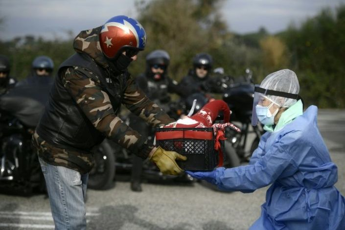 As Italy enters new restrictions, Harley Davidson fans brought Christmas gifts to medical workers in Rome. Photo: AFP