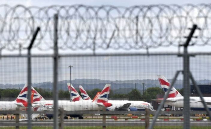 Aircraft grounded due to the COVID-19 pandemic, including planes operated by British Airways, are pictured on the apron at London Gatwick Airport near Crawley, southern England om May 1, 2020. Photo: AFP