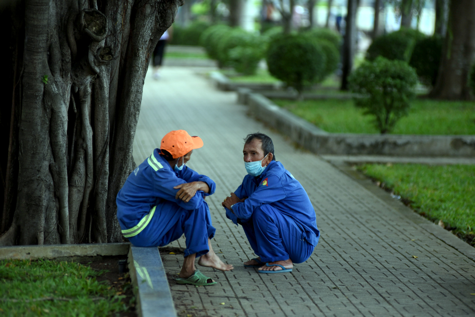 Two men sit at a park in Binh Thanh District, Ho Chi Minh City, December 22, 2020.