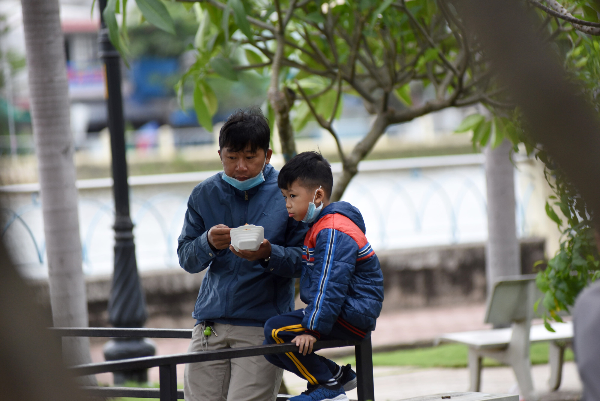 A man and his son are pictured at a park in Ho Chi Minh City, December 22, 2020. Photo: Le Phan / Tuoi Tre