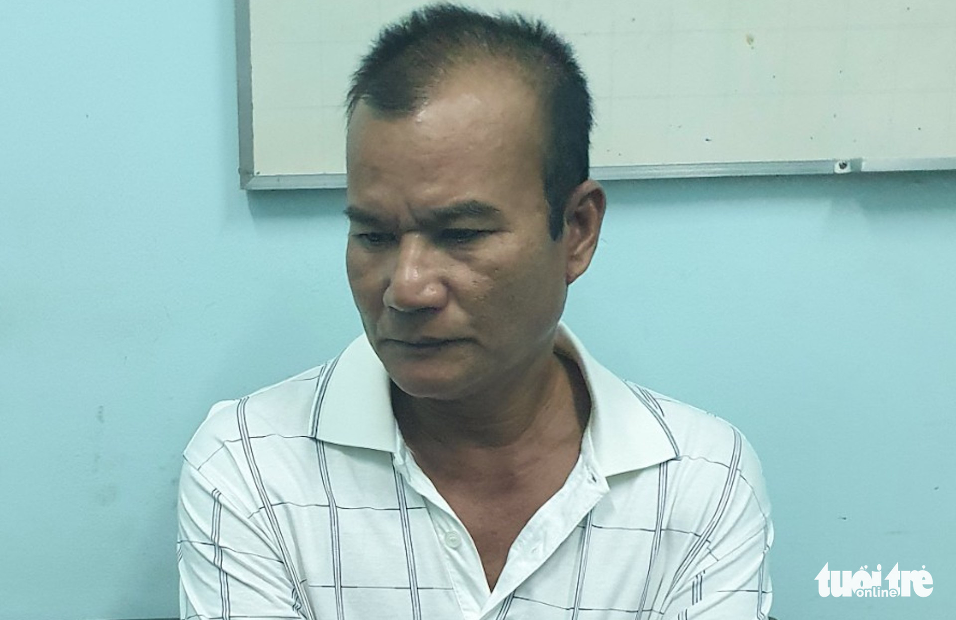Kim Anh is held at the police station in Tra Vinh Province, Vietnam in this supplied photo.