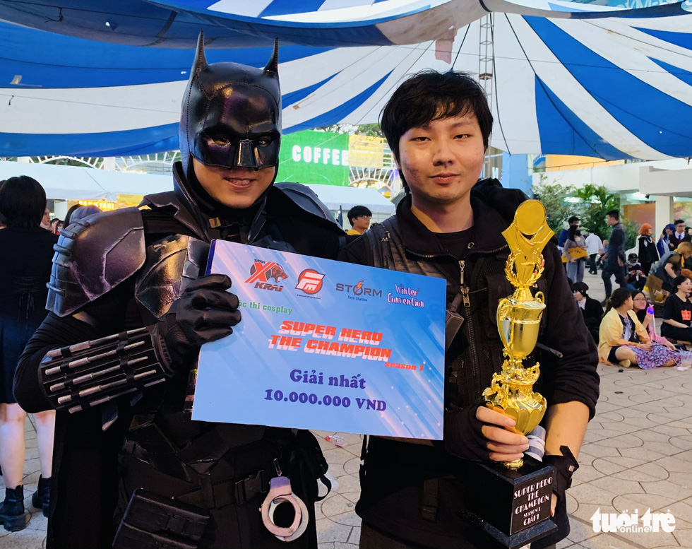 Nguyen The Quan (left) wins the first prize at the cosplay contest Super Hero The Champion Season 1 for his Batman costume in District 5, Ho Chi Minh City, December 27, 2020. Photo: Phuong Nam / Tuoi Tre
