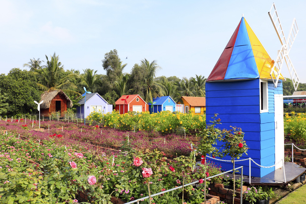 Vibrantly-colored cabins are seen at a botanical garden in Ho Chi Minh City's Nhi Binh Ward.