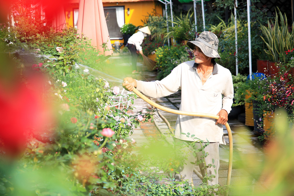 A gardener waters flowers at a botanical garden in Ho Chi Minh City's Nhi Binh Ward.