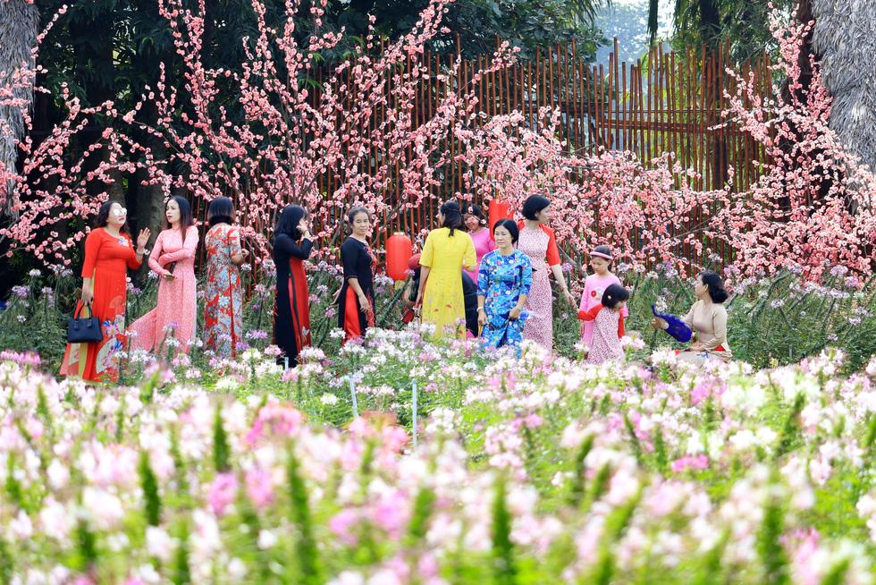 Visitors tour a botanical garden in Ho Chi Minh City's Nhi Binh Ward.