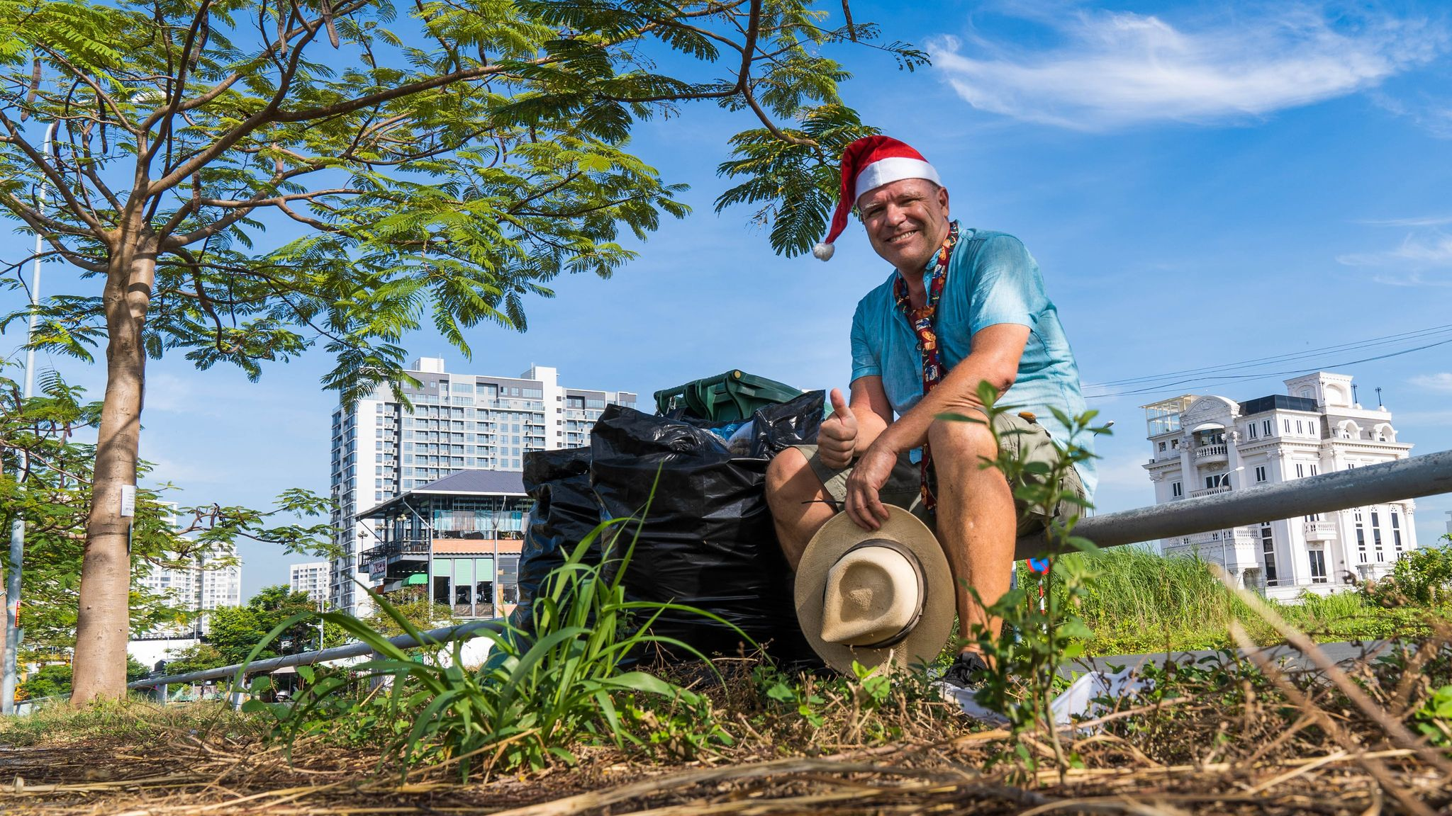 John Petter Klovstad from Norway poses for a picture with a bag of rubbish he picked up during his morning jogging routine in December in Ho Chi Minh City. Photo: Supplied