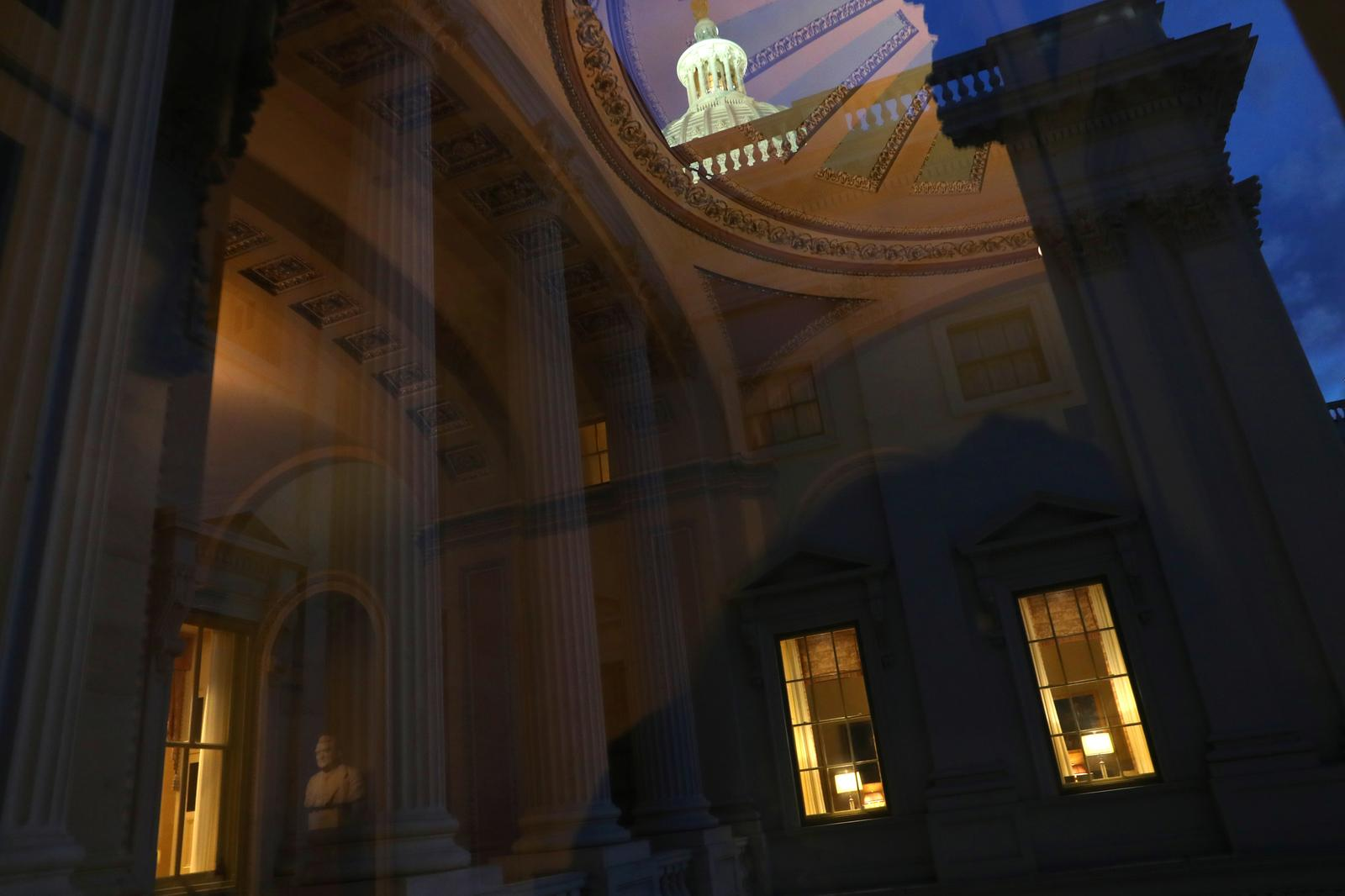 Office lights are seen at the U.S. Capitol as lawmakers work into the evening while the U.S. Senate face a decision over approving 2,000 dollars stimulus checks on Capitol Hill in Washington, U.S., December 30, 2020. Photo: Reuters