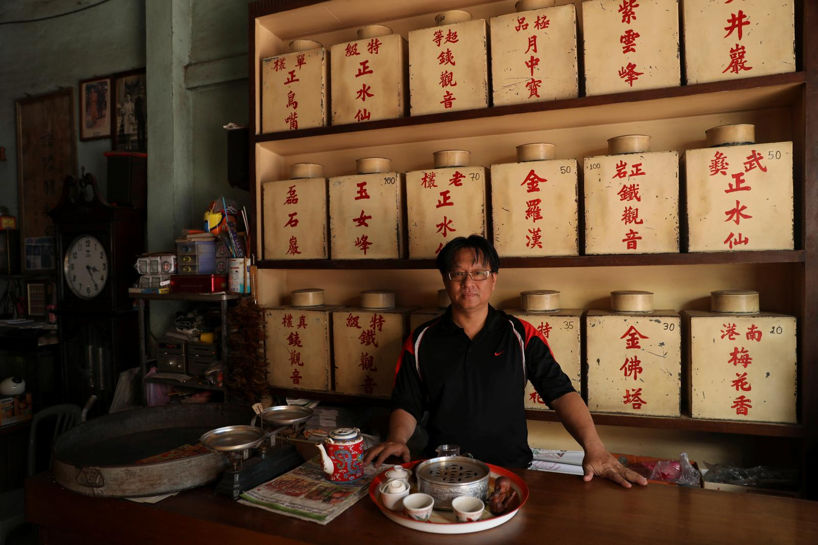 Surin Sae-Ton, 50, poses for a photograph in his tea shop that he runs across the river from the shopping mall Iconsiam in Bangkok, Thailand, January 18, 2019.  Photo: Reuters