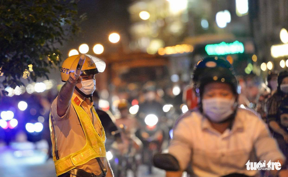 A traffic policeman orchestrates traffic at Bach Dang Port area in Ho Chi Minh City.