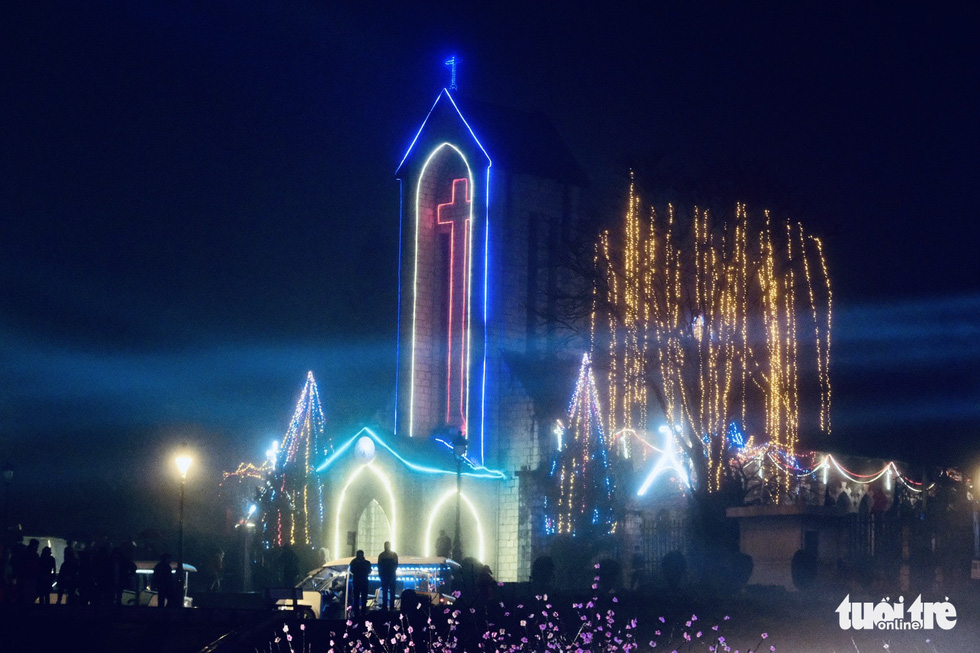 The Stone Church is lighted up with decorative lights in Sa Pa Town, Lao Cai Province, Vietnam, December 31, 2020. Photo: Nam Tran / Tuoi Tre