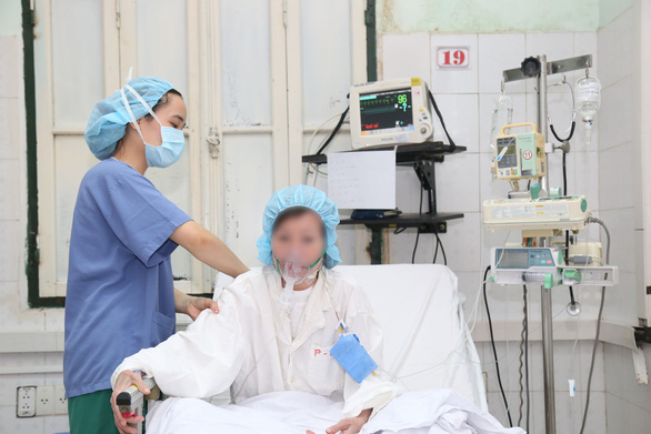 A patient is taken care of after receiving organ transplant surgery at Viet-Duc Friendship Hospital in this photo supplied by the hospital