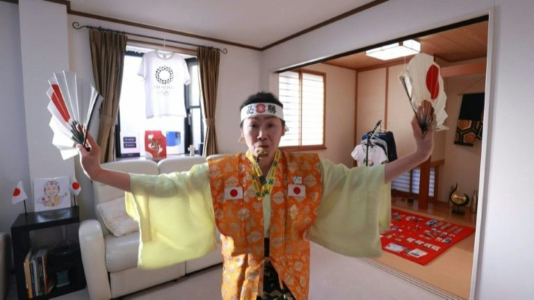 Olympic super-fan determined to welcome world to Tokyo. Photo: AFP