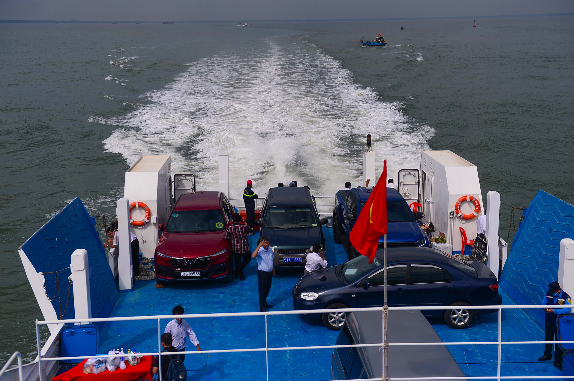 <em>Automobiles are transported along the Can Gio-Vung Tau ferry route on January 4, 2021. Photo: </em>Quang Dinh / Tuoi Tre