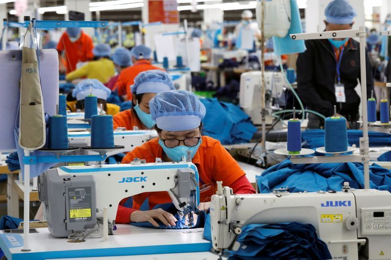 Workers make garment products for export at a factory in Hung Yen Province, Vietnam. Photo: Reuters