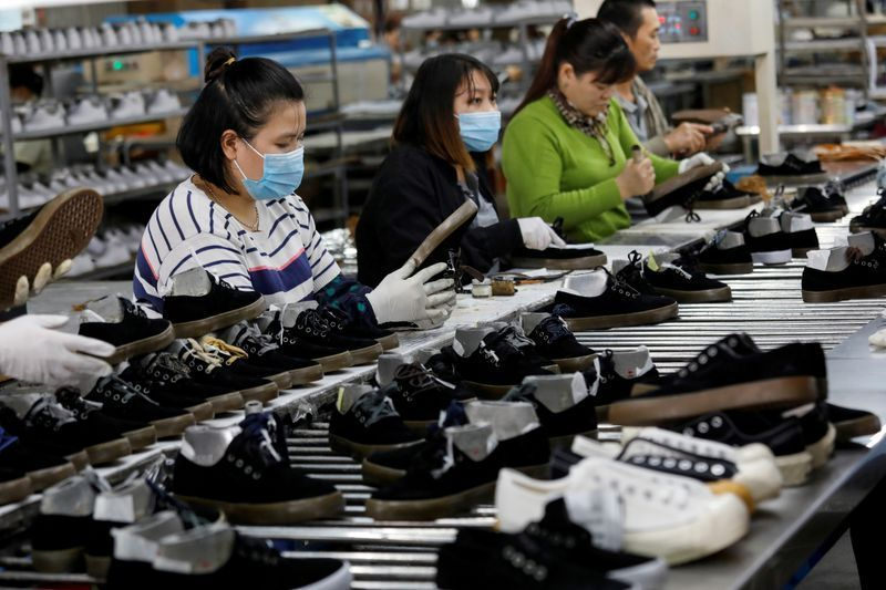 Workers make shoes for export at a factory in Hanoi, Vietnam. Photo: Reuters