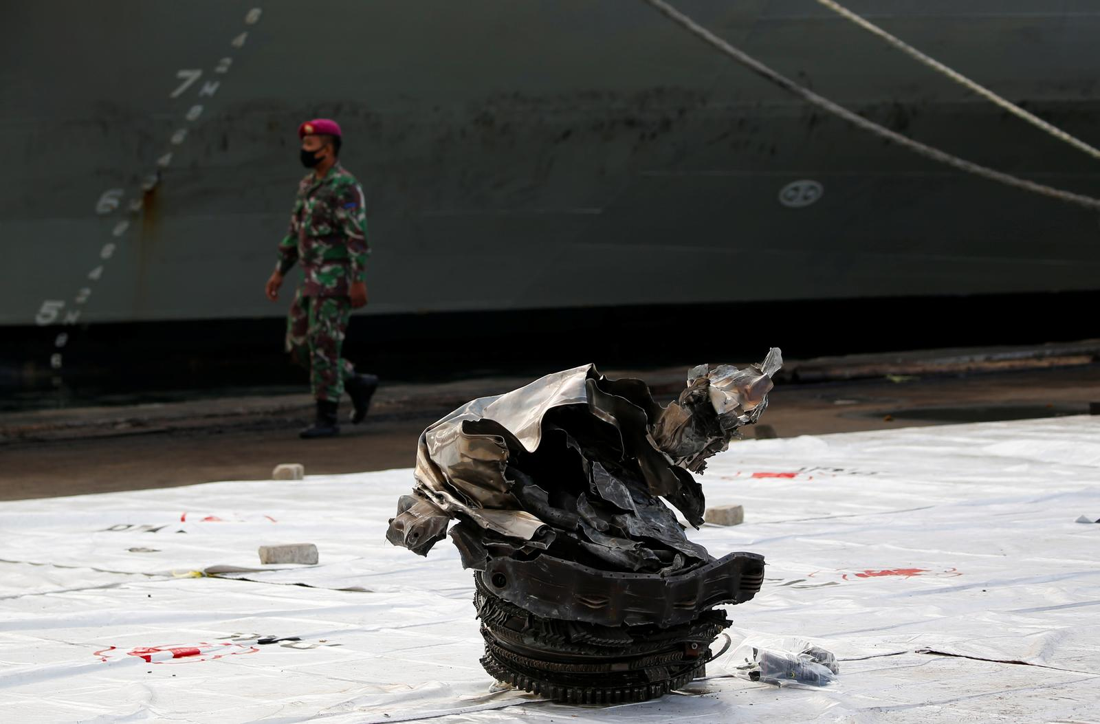 A debris found off the sea which believed as the remain turbine of Sriwijaya Air flight SJ 182, which crashed to the sea, is seen as a member of Indonesian Navy walks at Tanjung Priok port in Jakarta, Indonesia, January 11, 2021. Photo: Reuters