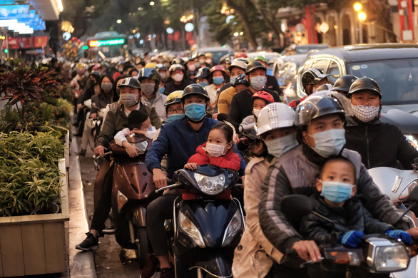Downtown Hanoi sees unusual crowdedness on first day of Lunar New Year