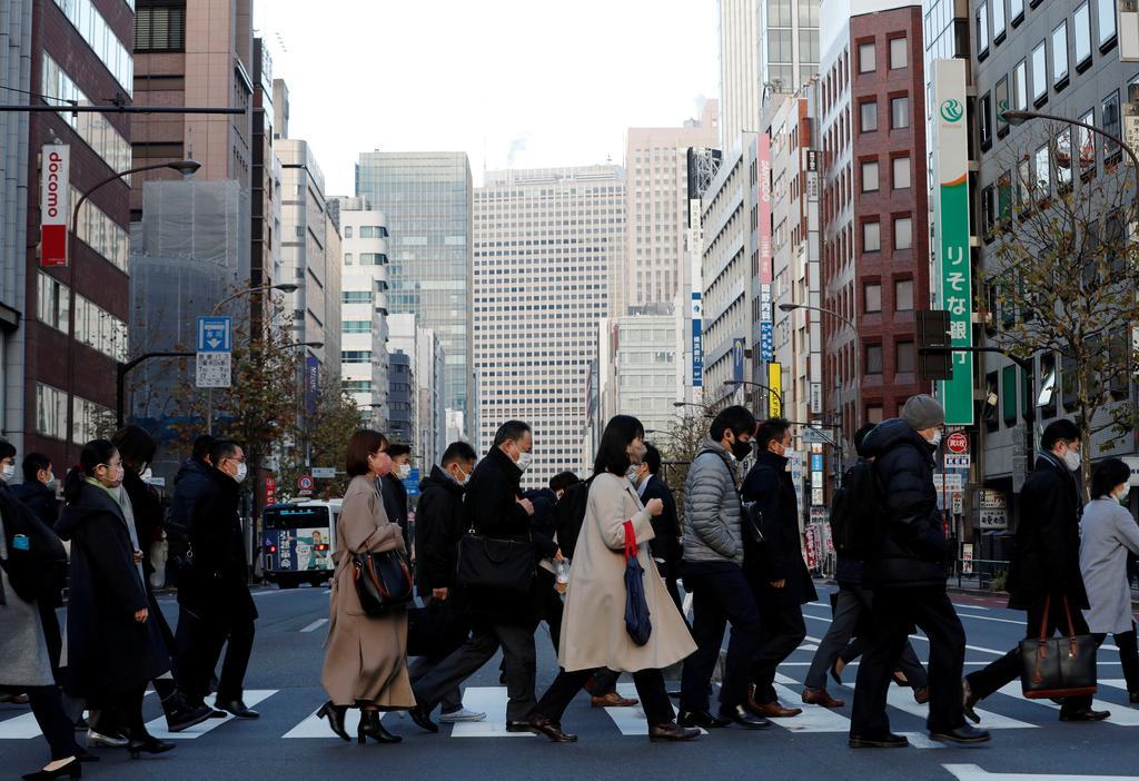 Japan downgrades fourth-quarter GDP as companies scale back spending